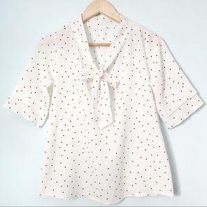 White polka dotted short sleeve blouse